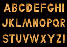 Golden letters of the Latin alphabet Stock Images