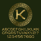 Golden letters and numbers with K initial monogram. Royalty Free Stock Image