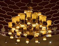 Golden  Chandelier Lighting on the ceiling Stock Image
