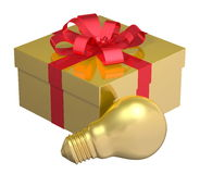 Golden light bulb near golden gift box with red bow Stock Photography