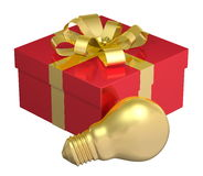 Golden light bulb near red gift box with golden bow Stock Photo