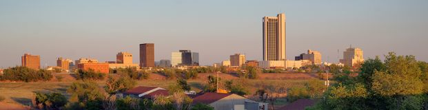 Golden Light hits the Buildings and Landscape of Amarillo Texas. A long panoramic view of the north Texas town metro area of Amarillo stock image