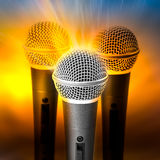 Golden light on microphone Stock Images