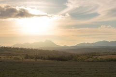 Golden light over fields and mountains Royalty Free Stock Photo