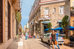 Golden light in a tropical City in Caribbeans. Havana, Cuba - March 6, 2016: Street scene in a small square in Old Havana, Cuba Royalty Free Stock Photos