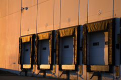 Golden light on the warehouse Stock Photos