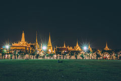Golden light of Wat Phra Kaew from Sanam Luang Royalty Free Stock Images