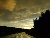 Golden light, wet roads, storm clouds, motorcycles Royalty Free Stock Photos