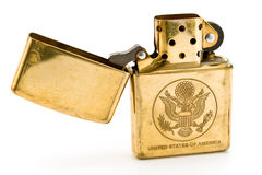 Golden lighter with carved United States seal Royalty Free Stock Image