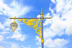Golden lighting pole on blue sky Stock Photography