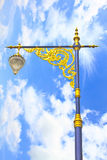 Golden lighting pole on blue sky Stock Photo