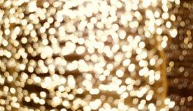 Golden lights blur. Golden casino style light spots chain blur Stock Photos