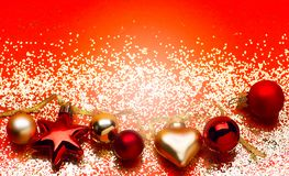 Golden lights with christmas tree decoration on red background royalty free stock images