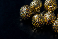 Golden lights garland on dark background. Christmas decoration Royalty Free Stock Photo