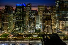 Golden lights of the San Francisco skyline and Salesforce Transit Center Park. At the bottom royalty free stock image