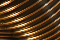 Golden lines abstract. Curved golden bars Stock Photos