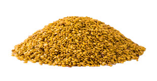 Golden linseed on white background Royalty Free Stock Image