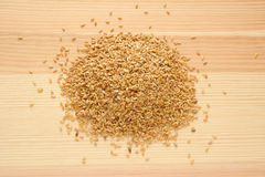 Golden linseed on wood Royalty Free Stock Photography