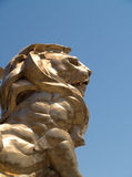 Golden lion. A golden lion statue in Las Vegas for a strong chromatic contrast with the blue sky Stock Images