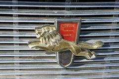 Lion Emblem from a Chrysler New Yorker. The golden lion emblem used in a 1960 Chrysler New Yorker station wagon. It is located in the front grill Stock Photos