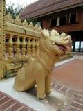 Golden lion guarding Khong Chiam temple. Lion the guardian of Wat Khong Chiam on Khong river bank , border between Thailand and Laos Royalty Free Stock Photos