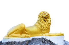 Golden lion sculpture. The golden lion sculpture in Thai temple Royalty Free Stock Photos