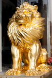 Golden lion sculpture in the entrance Stock Image