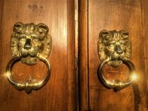 Golden lions, double faces, door details. Liberty style architecture, art and design, beauty and brilliance, vintage mood and entrance stock photo