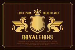 Golden lions with wings, crown and shield. Royalty Free Stock Image