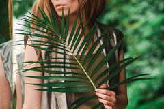 Lips of a girl with a fern branch Stock Images
