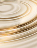 Golden liquid ripples Stock Images