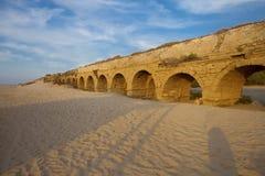 Golden-lit stones of Roman aqueduct Royalty Free Stock Image