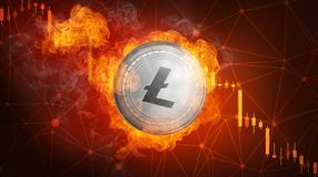 Golden Litecoin coin falling in fire flame. Golden Litecoin coin in fire flame is falling. Burning crypto currency Litecoin falling down, blockchain Royalty Free Stock Photos