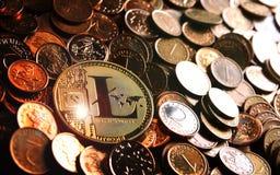 Golden Litecoin on coins. Golden  Litecoin crypto currency on heap of golden coins Stock Photos