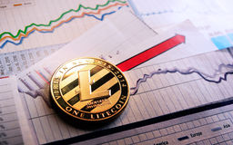 A golden litecoin on graph and diagrams. Background. concept of trading crypto currency Royalty Free Stock Image