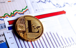 A golden litecoin on graph and diagrams. Background. concept of trading crypto currency Stock Image