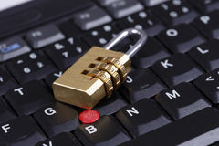 Golden lock on black keyboard - computer security concept Stock Photos