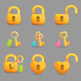 Golden locks and keys with charms Royalty Free Stock Photography