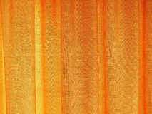Golden looking curtain texture for background of any contents object. Stock Photography