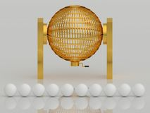 Golden lottery cage with white balls Royalty Free Stock Photography