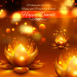 Golden lotus shaped diya on abstract Diwali background Stock Photo