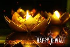 Golden lotus shaped diya on abstract Diwali background Stock Image