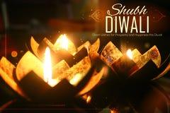 Golden lotus shaped diya on abstract Diwali background Royalty Free Stock Photography