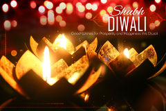 Golden lotus shaped diya on abstract Diwali background Stock Image
