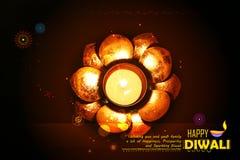 Golden lotus shaped diya on abstract Diwali background Stock Photos