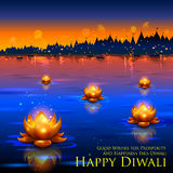 Golden lotus shaped diya floating on river in Diwali background Royalty Free Stock Photography