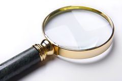 Golden loupe close-up. Royalty Free Stock Image
