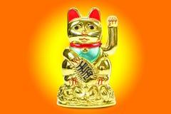 Lucky cat  on yellow orange background Royalty Free Stock Photo