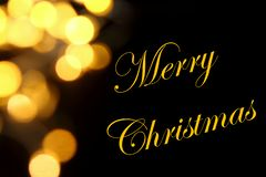 Gold Christmas lights soft focus bokeh background with Merry Christmas. Golden luxury Christmas lights soft focus bokeh background and Merry Christmas royalty free stock photography