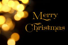 Gold Christmas lights soft focus bokeh background with Merry Christmas. Golden luxury Christmas lights soft focus bokeh background and Merry Christmas royalty free stock photo
